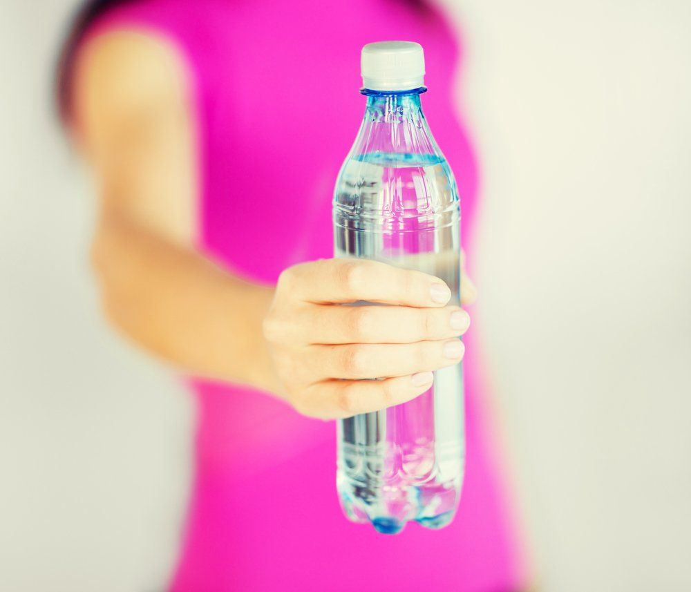 Women with water bottle for dehydration