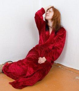 Tired Women in Red Bathrobe