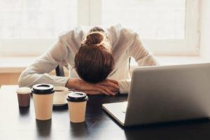 Woman Fatigue At Desk Computer