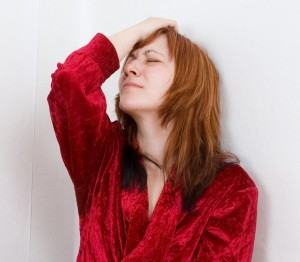 Women Anxiety Depression in Corner in Red Bathroab CROPPED
