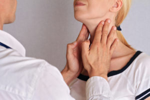 women-getting-thyroid-examined